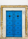 Blue aged door with ornament and tiles from Sidi Bou Said. In Tunisia Stock Images