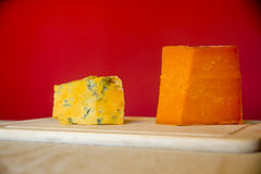 Blue and Aged Red Leicestershire cheese on a cutting board Stock Images