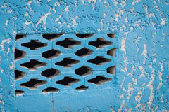 Blue aged street wall with brick holes Stock Photo