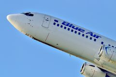 Blue air commercial airplane takeoff from Otopeni airport in Bucharest Romania. Plain spotters close up royalty free stock photo