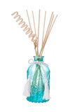 Blue air freshener bottle with scented sticks. Isolated on white Stock Images