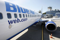 Blue Air plane parked at Bucharest Baneasa airport Stock Images