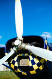 Blue airpane parked on the grass at the airfield Royalty Free Stock Images