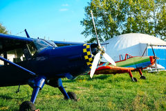 Blue airpane parked on the grass at the airfield Stock Photo