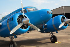 Blue airplane. Small blue airplane near hangar Royalty Free Stock Images