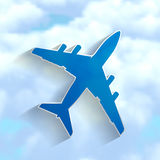 Blue airplane on a cloudy sky Stock Photos