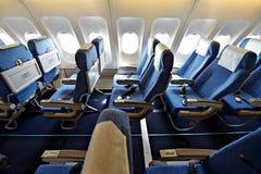 Blue airplane empty seats Royalty Free Stock Photos