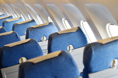 Blue airplane empty seats Royalty Free Stock Photography