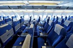 Blue airplane empty seats Stock Photos