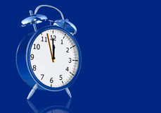 Blue alarm clock Stock Images