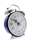 Blue alarm clock. Old blue alarm clock on a white background Stock Image