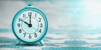Blue alarm clock banner Royalty Free Stock Photography