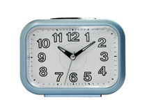 Blue alarm clock in direct view Royalty Free Stock Image