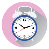 Blue alarm clock. Flat style. Blue alarm clock on pink background, with shadow. Flat style Royalty Free Stock Image