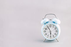 Blue alarm clock on gray background Stock Photo
