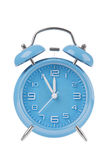 Blue alarm clock with the hands at 11am or pm isolated on a white background Stock Photo
