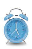 Blue alarm clock with the hands at 5 am or pm isolated on a white background Stock Photo