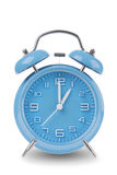 Blue alarm clock with the hands at 1 am or pm isolated on a white background Stock Photos