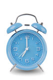 Blue alarm clock with the hands at 7 am or pm isolated on a white background Royalty Free Stock Photo