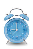 Blue alarm clock with the hands at 9 am or pm isolated on a white background. One of a set of 12 images showing the top of the hour starting with 1 am / pm and Royalty Free Stock Image