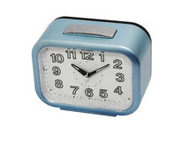 Blue alarm clock in oblique view. Simple blue alarm clock at 10.10 o'clock in left upper oblique view, isolation on white background Stock Photo