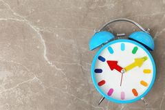 Blue alarm clock on table. Time change concept Royalty Free Stock Image