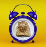 Blue alarm clock with toast bread heart concept isolated on yellow background Royalty Free Stock Photo