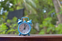 Blue alarm clock. Used to tell time Royalty Free Stock Photography