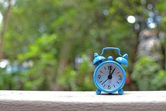 Blue alarm clock. Used to tell time Royalty Free Stock Images