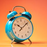 Blue alarm clock Stock Images