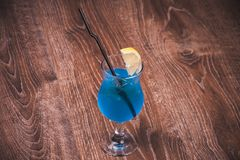 Blue alcohol cocktail in high glass Royalty Free Stock Photo