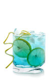 Blue alcohol cocktail with lemon slices Stock Image