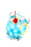 Blue alcohol cocktail with maraschino Royalty Free Stock Photo