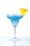 Blue alcohol cocktail with pineapple Royalty Free Stock Photography