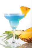 Blue alcohol cocktail with pineapple Royalty Free Stock Images