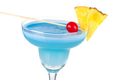Blue alcohol cocktail with pineapple and cherry Royalty Free Stock Photo