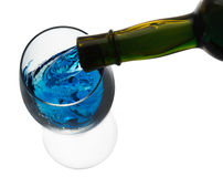 Blue alcohol drink pouring in a glass isolated on the white back Royalty Free Stock Photo