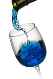 Blue alcohol drink pouring in a glass isolated on the white back Royalty Free Stock Photography