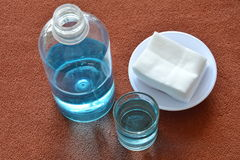Blue alcohol for wash wound in glass and clean white cotton Royalty Free Stock Image