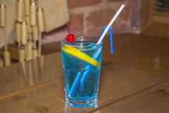 Blue alcoholic cocktail in the faceted glass. Stock Image