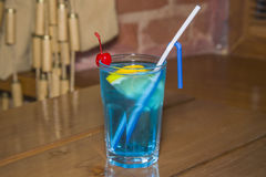 Blue alcoholic cocktail in the faceted glass. Stock Photography