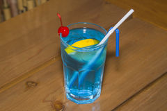 Blue alcoholic cocktail in the faceted glass. Royalty Free Stock Photo