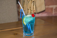 Blue alcoholic cocktail in the faceted glass. Stock Images