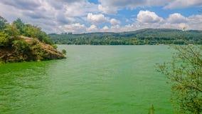 Green Water reservoir in Brno-Bystrc, Czech Republic. Blue-algae bloom plague on the Brno reservoir in summer in the Czech Republic royalty free stock images