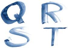 Blue alphabet. Grunge handwritten ink alphabet, isolated on white background. Letters QRST royalty free stock image