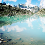 Blue Alpine Lake vintage effect. Caucasus Mountains, Russia. Royalty Free Stock Image