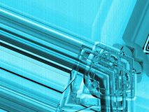 Blue aluminum background. Metal pipes and abstract technological components. industrial concept. Stock Photography