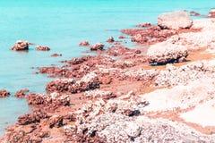 Blue amazing azure coloured sea water with granite rocks in Prachubkeereekhan Thailand. Granite rocks sea royalty free stock photos