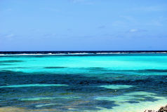 Into the blue. The amazing rich and varied colors of the Caribbean ocean Royalty Free Stock Photo