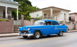 Blue American classic car in cuba on the road Stock Images
